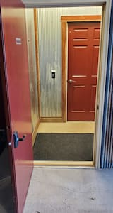 Level, barrier-free entry to elevator access