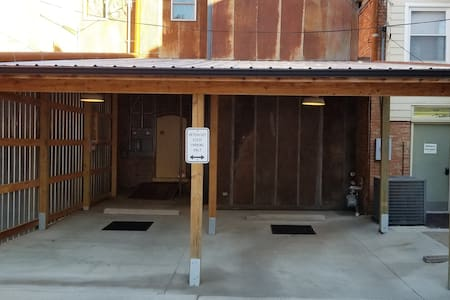 Well-lit entry from carport to elevator