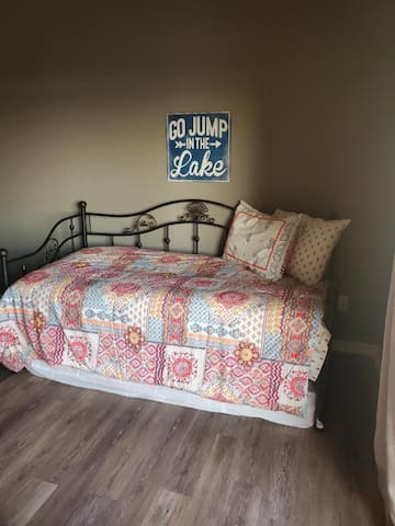 Trundle bed with mattress on top and pull out mattress below.