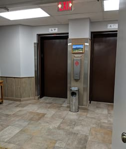 Two elevators from the main lobby. Elevator doors each measure 42 inches.