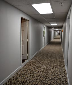 The hallway is well lite 24 hrs a day and measures 68 inches.