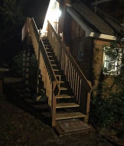 This is the steps and entry to the upstairs apartment where you will stay. This picture taken at night to show that it is lighted well so you can see to get in.
