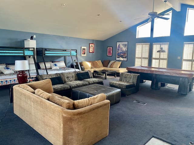 The second living area is a bunkhouse over the garage with two twin/full bunk beds, a game area, a TV with Netflix, full bathroom and kitchenette.