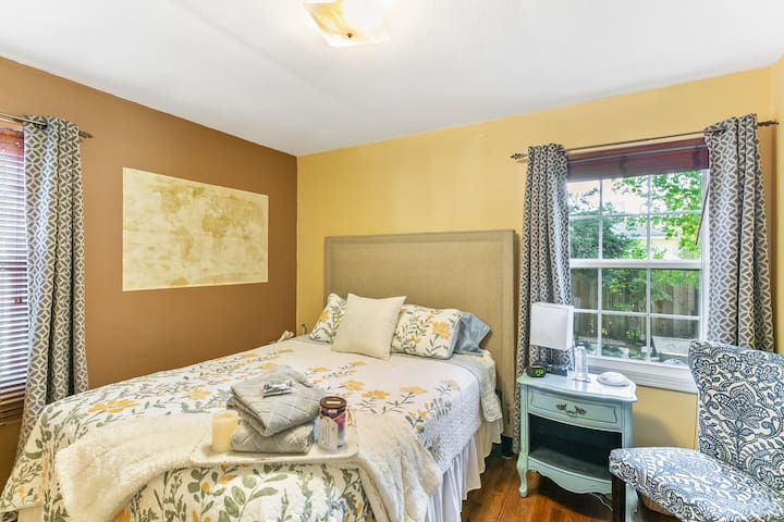 Rear bedroom has darkening curtains and a white noise machine if you are a light sleeper.  This room contains a queen bed.  Lots of storage under bed as it is on a tall platform.