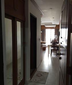 Flat walkway to the bathroom and living room