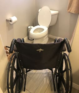 The wheelchair goes through the bathroom door, but it's really tight