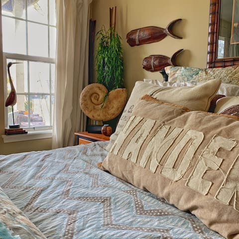 World map linens from Pottery Barn adorn the queen size bed.