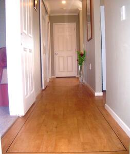 Hallway width is 1 metre and is the centre hub of all rooms.  The 2 bedrooms and bathroom are accessible with sliding doors (77cm) and on the other side is door-less entrances to the kitchen and livingroom.  At one end is the internal garage access