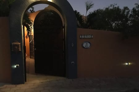Entry at the front gate of property. Light switch on right, and lights plus motion lights as you walk into courtyard.