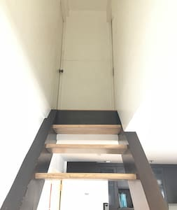 Stairs going up to Bedroom 1 and Bedroom 2