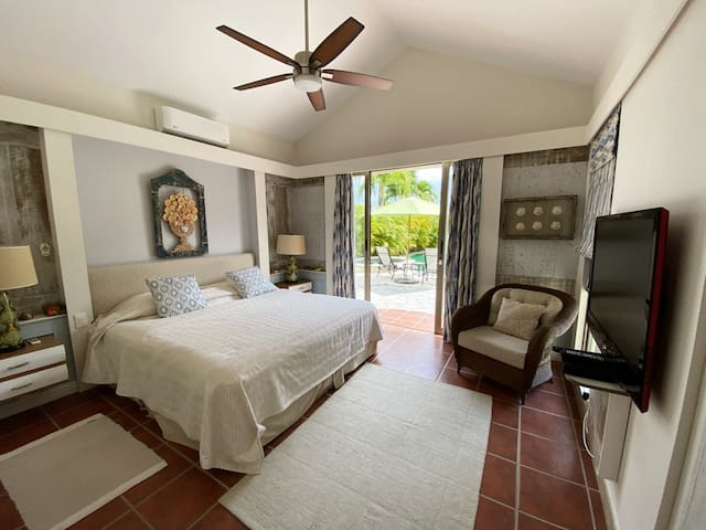 Relaxing-Master-bedroom.  Super comfy King size bed and doors straight out to the pool and terrace