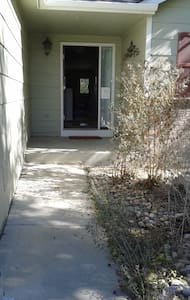 flat concrete path from driveway up to entrance. 2 steps to enter, a small ramp is sufficient.