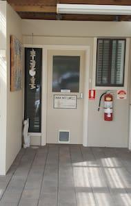 Pathway to door of Inna Nutshell. Light switch is on right hand side of door.