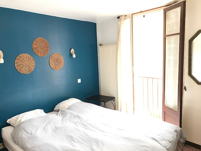 bedroom with double bed and small balcony