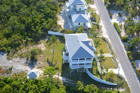 Level off street parking and walkways to house and beach.