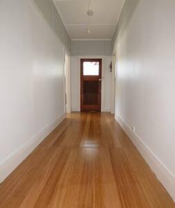 Long wide hallway and front door.