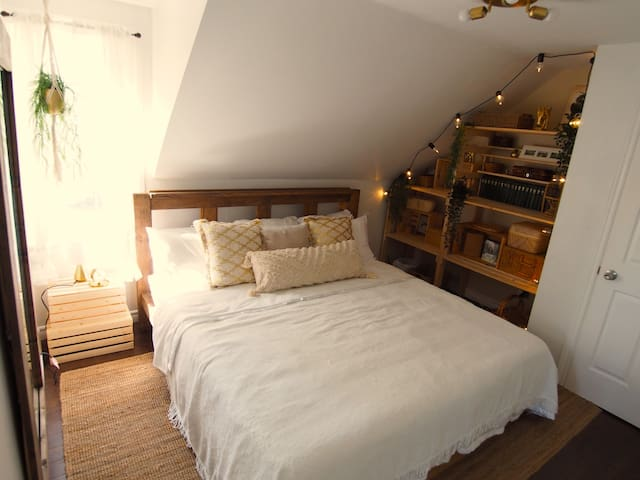 Boho bedroom with king size bed.