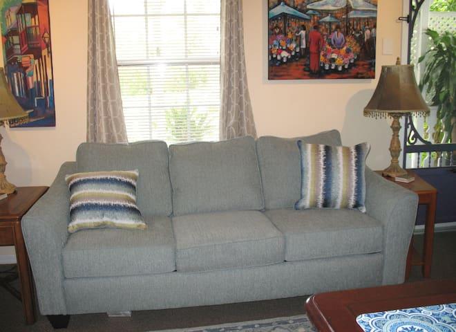 Queen sleeper sofa with gel foam mattress in living room