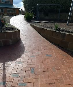 gently sloping paved path from car parking to the front door.