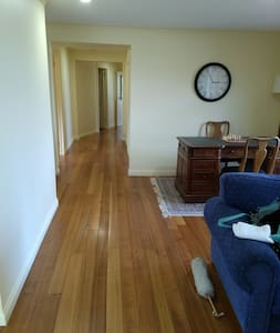 Wide hallway leading from the kitchen living area to the bedrooms and rumpus.