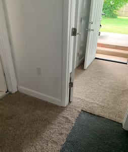 There is one bedroom that is on the same level as the main entry door. Beyond that bedroom is an exit to the backyard that requires two steps up.