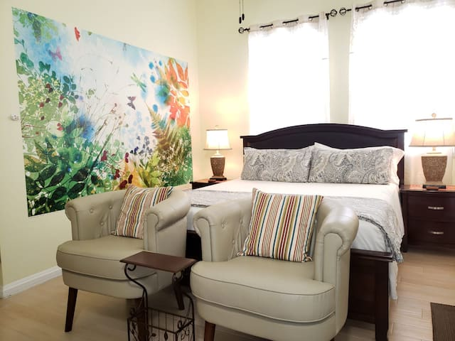 Relax in a comfortable sitting area and rest in a king size bed.