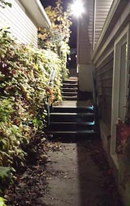 motion sensor lights at 3 points along walkway, handrail and lights on middle set of stairs