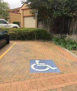 Disabled Parking across from the Studio