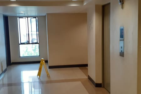 View from elevator exit @ 4th floor to unit hallway.