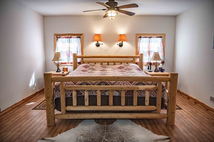 Upstairs 400 + sq. ft. Master with Amish made King,, 50 inch dish TV,  2 Futons, and a inflatable mattress.