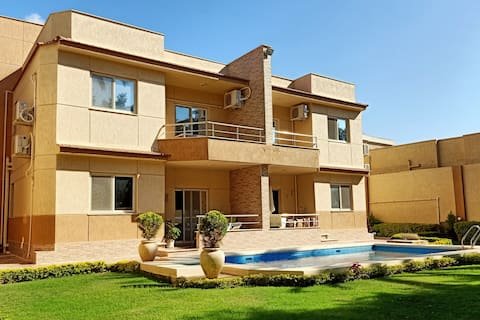 Cosy villa near airport with garden & pool view