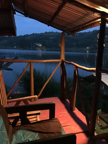 Our mixed dormitory in front of the entrance door with a small balcony where you can relax and enjoy the nature of Lake Bunyonyi.