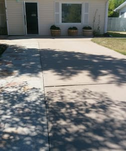 Driveway and concrete entrance path are on a very slight incline.