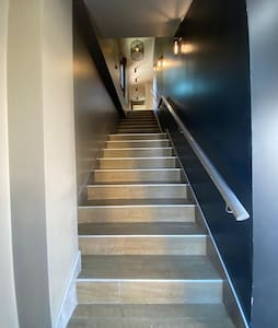 A private entrance door to access the staircase that leads you to the second floor where the unit is located