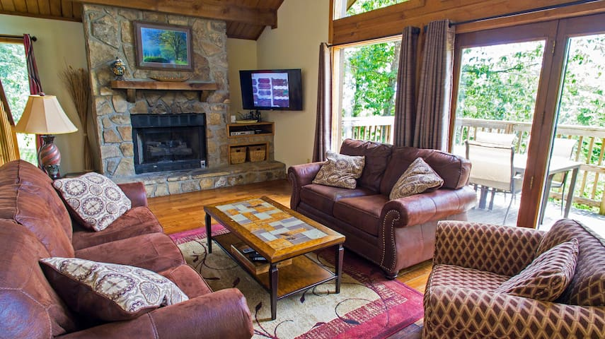 Living room, fabulous views, gas fireplace. Main level deck with seating for six.