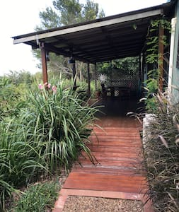 There is a pebble path that leads from the car parking space onto a gently sloping timber ramp onto the deck.