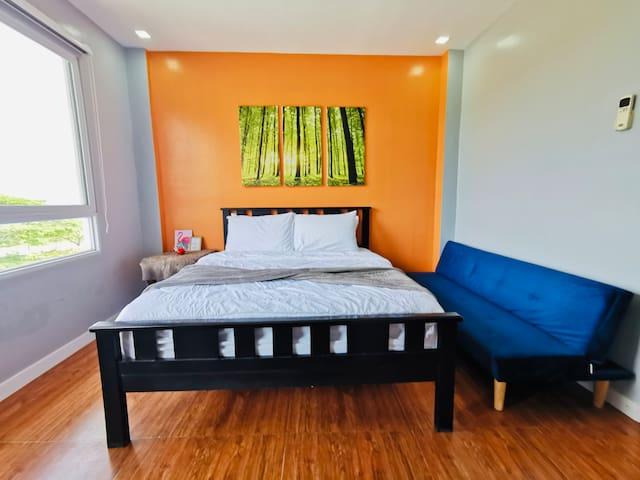 Room 4 - MASTER BEDROOM 2ND FLOOR facing Taal Lake  has own T&B