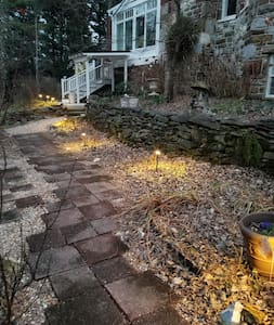 Well lit path and motion sensor lighting at entrance .