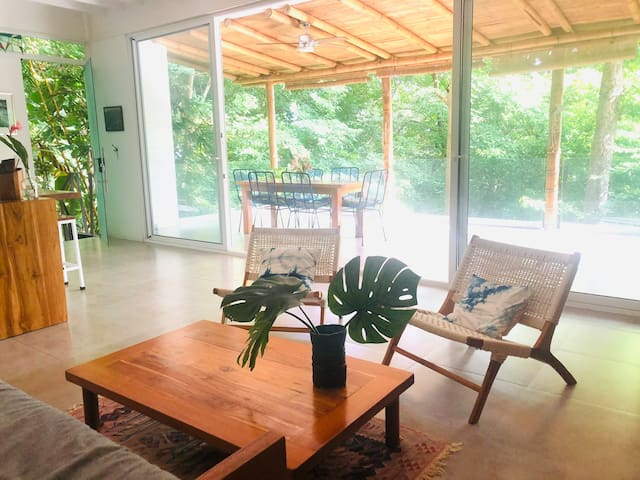 Beautiful jungle views from everywhere in the house. Custom shibori pillow, custom furniture and a super plush sofa for chilling out.