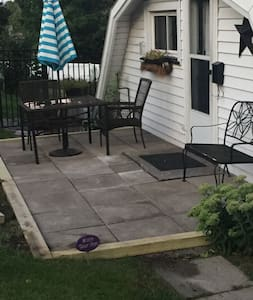 Small step from walkway to patio