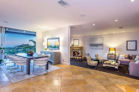"""This home is very open and expansive. Ground floor doesn't really have """"halls"""" everything just flows from room to room with ample space to get about."""