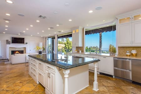 You can come into kitchen from garage which is flat starting with the driveway as one point of entry.