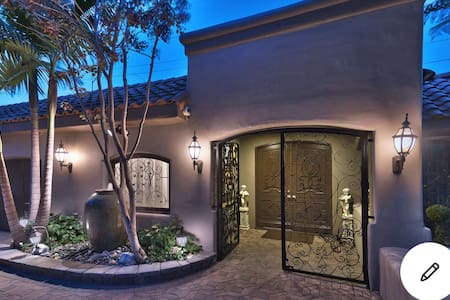 Driveway level with well lit front double entrance door.