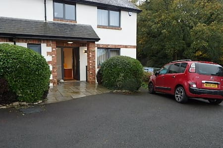 Entrance to house flat from where you park your car. There is a steep drive to street level