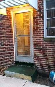 side door off driveway is a coear lit path from street.