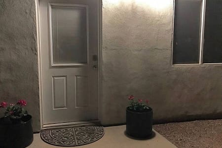 This is an evening photo of the guest house entrance. Easy no stairs are necessary to enter the space however walkways are granite as is the private parking area. There is a nice bedroom first floor and two others upstairs. Not ideal for wheel chair.