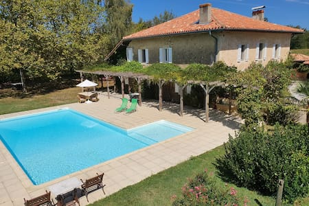 Secluded country house with large pool and garden.