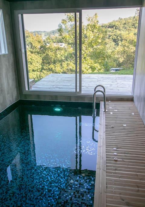 Logt 50m2, piscine intérieure et sauna privatif
