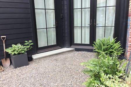 Enter through single door or open double doors.