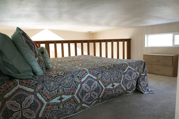 """The loft has a full size bed and plenty of space.  Kids love the loft and adults do too! Loft height is 40"""".  You can not stand in the loft."""